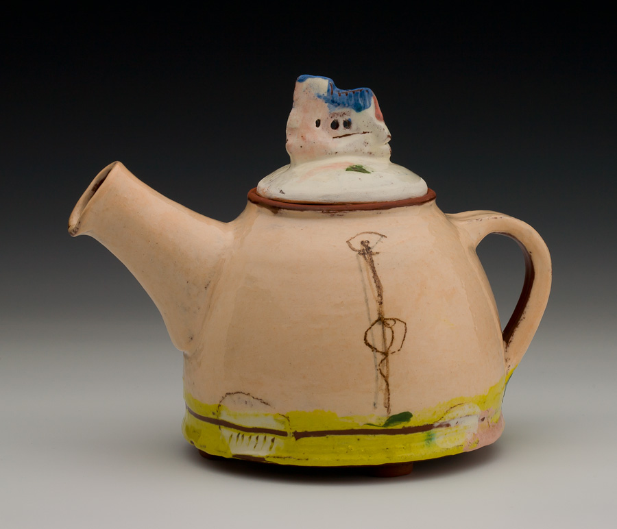 footed pink teapot